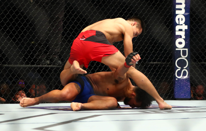 O Korean Zombie enterrou Dennis Bermudez no UFC Fight Night (Foto: Mark J. Rebilas/USA TODAY Sports)